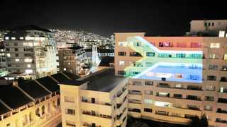 THE SOUTH African flag projected on an apartment building in Sea Point, Cape Town, this week. Rand Merchant Bank chief executive James Formby says the challenge facing the economy will be overcome only if the government, regulators, the broader financial services industry and business work together in partnership.     Armand Hough African News Agency (ANA)