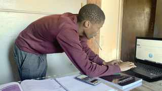 SANDILE NKABINDE, a first-year economics student at the University of Pretoria, prepares for his first online class. Picture: Sakhile Ndlazi
