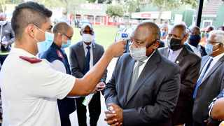 President Cyril Ramaphosa gets his temperature checked by a health worker during his visit to an isolation and quarantine facility at the Agricultural Royal Showgrounds in Pietermaritzburg. Picture: GCIS
