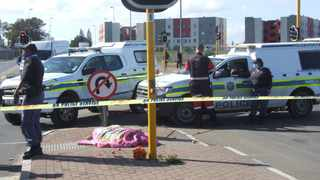 The first fatality occurred just after noon when a fruit seller was gunned down on the corner of Eon Way and Old Paarl Road in Scottsdene. Picture: Solly Lottering