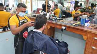Yogi's Barber Shop owner Yogesh Govan has had to introduce new health and safety measures during level 3 of the lockdown, but he says business is on track with many Capetonians looking for a haircut. Picture: Sam Spiller