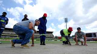 Mangaung Oval groundsman Nico Pretorius inspects the pitch on Sunday. Photo: Gerhard Steenkamp/BackpagePix