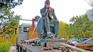 UCT's statue of Cecil John Rhodes is carted away in 2015 after much controversy about colonial relics on campuses. Picture: Ross Jansen