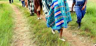 A police officer leads away initiates who were being kept at an illegal initiation school in Soweto. File picture: Itumeleng English/African News Agency (ANA).