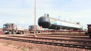 One of the storage tanks for the LPG terminal shown arriving from the port.