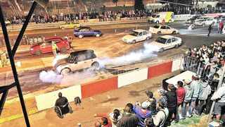 Racers warm up their tyres during a legal Friday-night 'Street to Strip' drag meeting at Cape Town's Killarney circuit. Many street racers, however, avoid these event because, they say, traffic officials wait outside to bust them for illegal modifications. File photo, Jason Boud