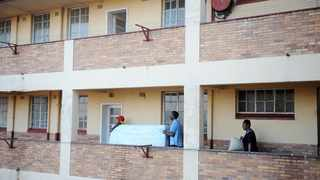 A group of close to 100 people forced their way into two unoccupied buildings in Selkirk and Kinross streets. Picture: Matthews Baloyi/ANA