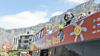 Tourists on the Cape Town City Sightseeing bus take photos. The city is a popular holiday destination and features in the 2018 Lonely Planet yearbook. Picture: Tracey Adams/ANA