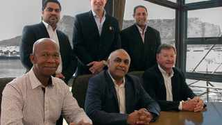 Back, from left: Samir Saban, chief executive of Premier Fishing & Brands, Craig Stanley and and Dino Moodley of Talhado Fishing. Front: Patrick Mbiko of Talhado Fishing, Khalid Abdulla, group chief executive of AEEI and Malcolm Stanley of Talhado Fishing in celebration of the completed deal yesterday. Photo: Supplied