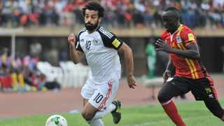 Godfrey Walusimbi chases down Mohamed Salah during a 2018 Fifa World Cup qualifier between Uganda and Egypt in Kampala last year. Photo: Ismail Kezaala/BackpagePix