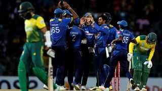 Sri Lanka celebrate after taking a wicket against South Africa in Tuesday's T20I. The Proteas were skittled out for just 98. Photo: REUTERS/Dinuka Liyanawatte