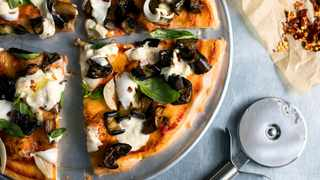 "Pizza is an Italian dish made famous when the world was ""made to be one"" and to have similar tastes for foods. Photo: NYT"