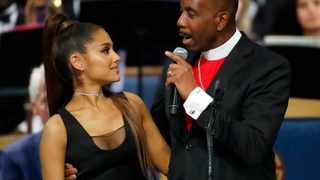 Bishop Charles H. Ellis, III and singer Ariana Grande after she performed during the funeral service for Aretha Franklin at Greater Grace Temple. Picture: Paul Sancya/AP