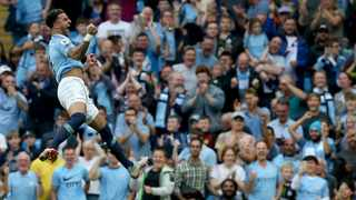 Kyle Walker leaps into the air after scoring his very first goal for Manchester City on Saturday. Photo: Nigel Roddis/EPA
