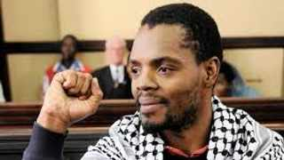 Wits student Mcebo Dlamini is accused of malicious damage to property, theft, possession of a dangerous weapon and public violence.