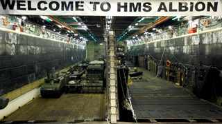 Military vehicles are seen in the loading dock of the HMS Albion, the British Royal Navy flagship amphibious assault ship, after the ship's arrival at Harumi Pier in Tokyo. File picture: Toru Hanai/Reuters