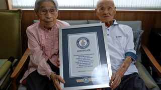 The world's oldest living married couple Masao Matsumoto (R) and Miyako Matsumoto poses with the Guinness World Record certificate at a nursing house in Takamatsu, Kagawa Prefecture, Japan. Picture: Kwiyeon Ha/Reuters
