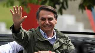 """Brazilian president-elect Jair Bolsonaro has urged a judge to join his government and promised to cut government advertising for media that """"lie."""" Picture: Reuters/Pilar Olivares"""