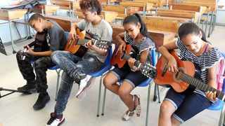 The Sekunjalo Delft Music Academy playing guitars. Survé Philanthropies will next week host an awards ceremony honouring those who have made a social impact. Picture: Supplied