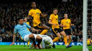Gabriel Jesus scores one of his two goals for Manchester City against Wolves on Monday night. Photo: Peter Powell/EPA