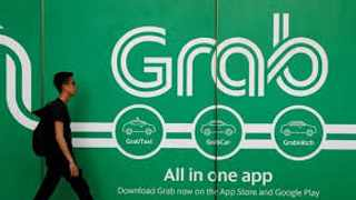 Grab is looking to raise another $2 billion this year to ramp up expansion, its Chief Executive Anthony Tan told Reuters.  Photo: REUTERS/Edgar Su/