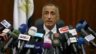 FILE PHOTO - Egypt's Central Bank Governor Tarek Amer speaks at a news conference in Cairo