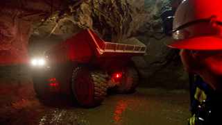 A truck travels underground to collect ore at the Chibuluma copper mine. Photo: Reuters