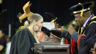 Holly Wasserfall aka Holly Rey a South African house musician graduated from the University of KwaZulu-Natal on Monday with an Honours degree in Media studies. Picture: Abhi Indrarajan/UKZN     House Musician, Ms Holly Wasserfall, aka Holly Rey graduated with an Honours degree in Media and Communication Cum Laude, from the University of KwaZulu-Natal (UKZN).  Her graduation ceremony was held on the UKZN Westville campus.  The Durban-born artist is well-known for her hit songs, 'Deeper',  'Joy', and 'You'.