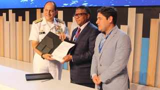 Colombia's Minister of National Defense: Guillermo Botero Nieto, Minister of Transport Fikile Mbalula and Colombia's Ambassador to South Africa Carlos Andres Barahona Nino. Mbalula received the flag as an official handover to South Africa for the next World Maritime Day 2020. Picture: Supplied.