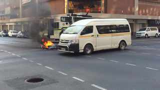 Tshwane municipal workers intensified their protest over 'benchmarking payments' when they went on the rampage, burning wheelie bins and destroying fire hydrants in the Pretoria CBD. Picture: Rapula Moatshe