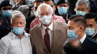 Former Malaysian prime minister Najib Razak, centre, wearing a face mask with his supporters arrives at the courthouse in Kuala Lumpur. Picture: Vincent Thian/AP