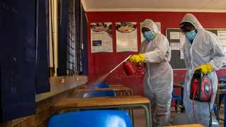 A disinfection team works in a classroom in Johannesburg. File picture: Themba Hadebe/AP