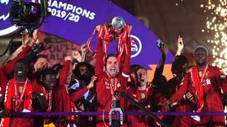 Liverpool captain Jordan Henderson hoists the Premier League trophy after their game against Chelsea on Wednesday. Photo: @LFC/Twitter