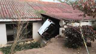 The bakkie Rajpaul Andhee was driving when it crashed into an abandoned house after he and his wife, Kamla, were shot. Picture: Reaction Unit South Africa