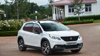 Upright grille, black wheel arch extensions and a lifted suspension give an assertive look