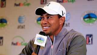 Tiger Woods talks to reporters during a news conference in Pebble Beach, California.