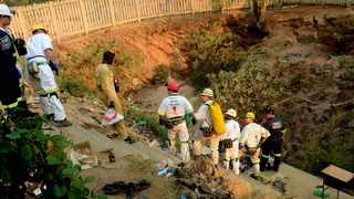 Mine Rescue Service personnel and some illegal miners at the disused mineshaft near Langlaagte. File picture: Boxer Ngwenya