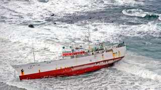 Cape Town - 120512 - The 50 meter Eihatsu Maru Japanese fishing ship built in 1986 ran aground just off Clifton Beach at 5:15AM on Saturday 12th May. After a failed attempt on Saturday evening to pull the ship off the shore, another rescue operation was called off on Sunday evening as surf conditions were not favorable. Picture: David Ritchie