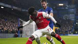 Chelsea's Cesar Azpilicueta and Bukayo Saka of Arsenal battle for the ball in an earlier Premier League match. Picture: Will Olivier/EPA