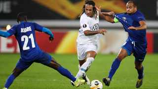 FILE - Wolfsburg's Kevin Mbabu, centre, battles for the ball with Gent's Nana Akwasi Asare, left, and Vadis Odjidja-Ofoe. Photo: Francisco Seco/AP