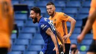 Wolverhampton Wanderers' Matt Doherty, right, watches as Chelsea's Olivier Giroud celebrates after scoring his sides second goal during their English Premier League match at Stamford Bridge in London on Sunday. Photo: Daniel Leal-Olivas/AP