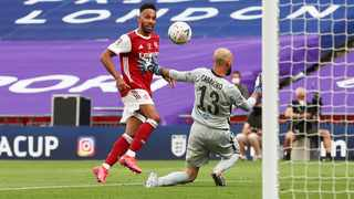 Arsenal's Pierre-Emerick Aubameyang scores the winning goal during their FA Cup final clash against Chelsea at Wembley Stadium in London on Saturday. Photo: Adam Davy/Reuters