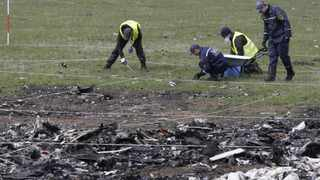 File photo: Investigators comb the crash site of Malaysian Airlines passenger jet MH17 near Donetsk, Ukraine. The Malaysian Airlines plane was shot down over Ukraine in July. Picture: Alexander Ermochenko