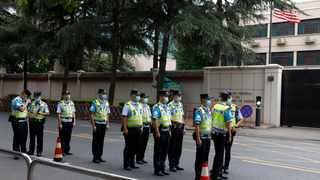 Chinese police officers form up in front of the United States Consulate in Chengdu in southwestern China's Sichuan province. Picture: Ng Han Guan/AP