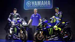 Yamaha Motor Racing Managing Director Lin Jarvis, centre, poses with his team's MotoGP riders Valentino Rossi, right, and Mavrick Vinales. Photo: Achmad Ibrahim/AP