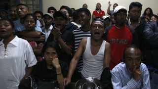 People react as votes are counted at a polling centre in the capital Antananarivo. Photo: Reuters
