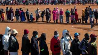 People affected by the coronavirus economic downturn line up to receive food parcels in Pretoria. Picture: Themba Hadebe/AP