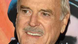 A jellyfish named after musician Frank Zappa and an ape named after comedian John Cleese (pictured).