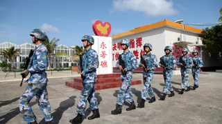 Soldiers of China's People's Liberation Army (PLA) Navy patrol at Fiery Cross Reef, in the Spratly Islands, known in China as the Nansha Islands. File picture: Reuters