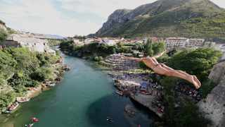 A man jumps from the Old Bridge during the 454th traditional diving competition in Mostar, Bosnia and Herzegovina. Picture: Dado Ruvic/Reuters